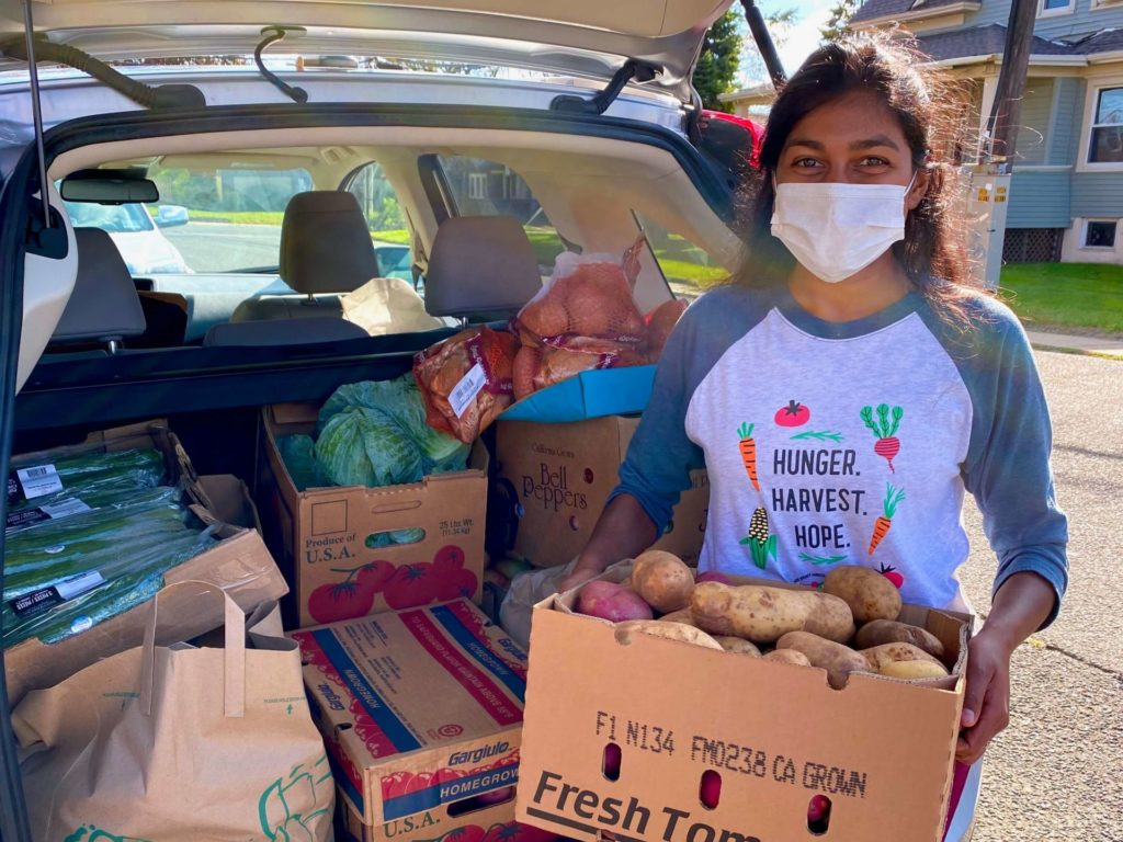 Woman with food donations